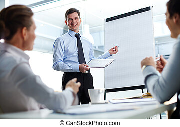 Business explanation - Cheerful businessman discussing a new...