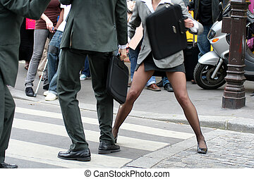 Bussinessmen and businesswoman fighting in the street (models)