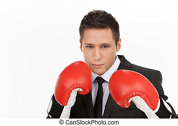 Business fighter. Confident young men in red boxing gloves looking at camera while standing isolated on white