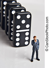 Business figurine and dominos