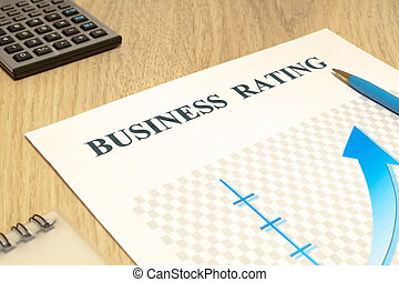 Business financial rating chart with pen and calculator.