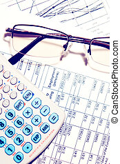 Business financial report chart with calculator and glasses