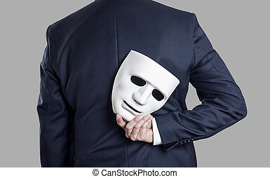 Business fraud concept. Businessman hide the mask in hand ...