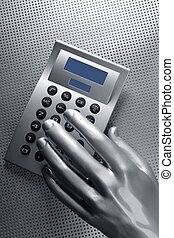 business futuristic silver hand calculator