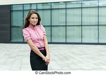 business girl looks into the camera