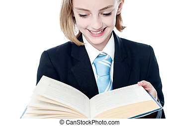 Business girl reading management book