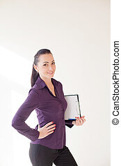 business girl stands with folder with the documents