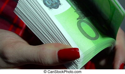 business girl with pack of money euro in hands