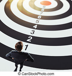 Business goals - Man on a big target with numbers