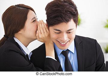 business gossip between businesswoman and businessman
