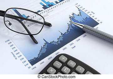 business graph - close up of stock market chart, glasses, ...