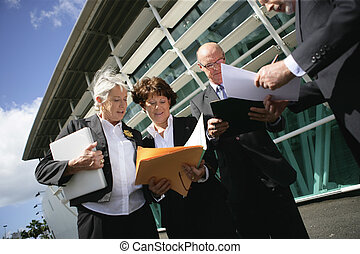 Business group having an outdoors meeting