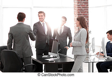 Business group of five people in the office planning a job
