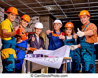 Business group people in builder helmet . - Business group...