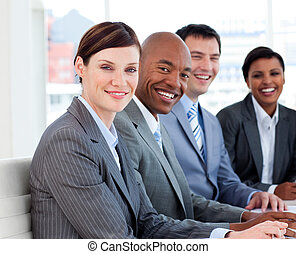 Business group showing ethnic diversity in a meeting. ...