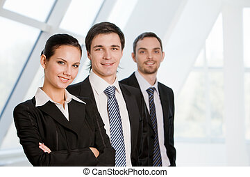 Business group - Portrait of confident co-workers standing...