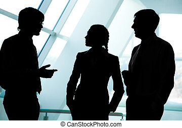 Business group - Three silhouettes of businesspeople...