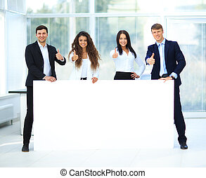 Business group with banner in office