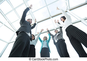 Business group with their hands in the air