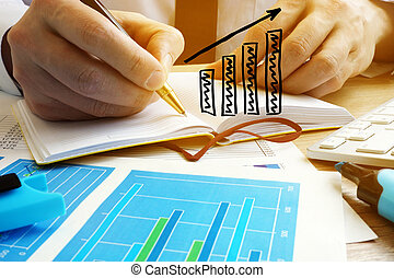 Business growing concept. Businessman analyze financial results.