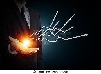 Business growth. - Hand holding a rising arrow, representing...