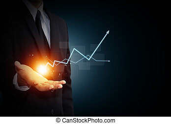 Business growth - Hand holding a rising arrow, representing ...