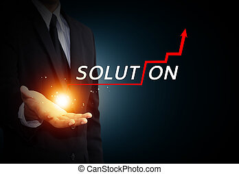 Business growth - Hand holding a rising arrow, representing...