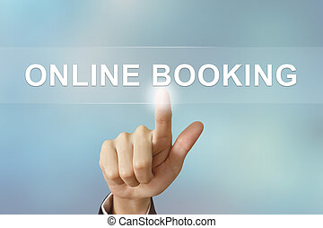 business hand clicking online booking button on blurred background