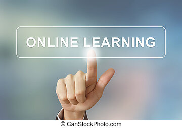business hand clicking online learning button on blurred backgro