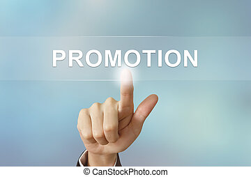 business hand clicking promotion button on blurred background