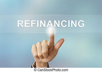 business hand clicking refinancing button on blurred background