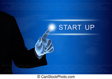 business hand clicking start up button on touch screen