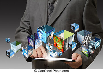 business hand holding a touch pad computer and 3d streaming images