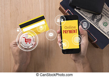 business hand holding credit card with smart phone and Payment online. concept mobile banking e-commerce internet technology.