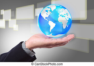 Business hand holding cystal globe on a touch screen background interface