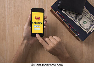 business hand holding smart phone and Shopping online. concept mobile banking e-commerce internet technology.