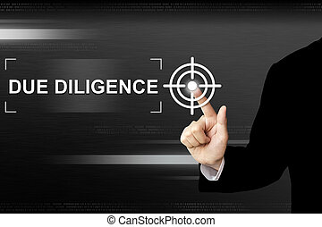 business hand pushing due diligence button on touch screen...