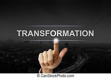 business hand pushing transformation button on black blurred background