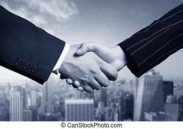 business hand shake and Manhattan
