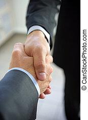 Business hand-shake