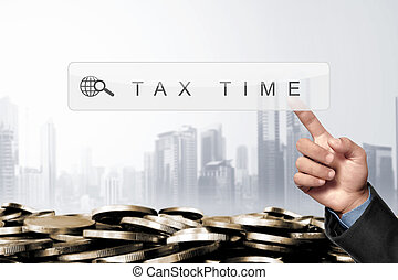 Business hand touching search engine bar with taxes keyword