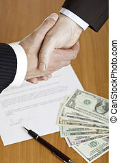 Business handshake after contract signature - Closeup of...