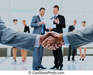 Business handshake and business people.