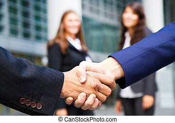 Business handshake and business peo