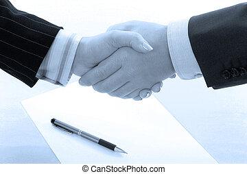 Business handshake deal in blue tone