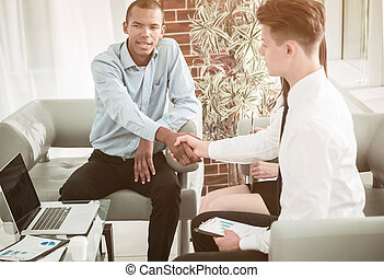 business handshake financial partners in the office