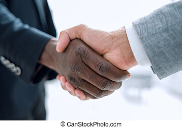 Business handshake in lofty office - Business people closing...