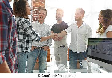 business handshake in modern office