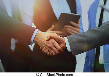 Business handshake in office