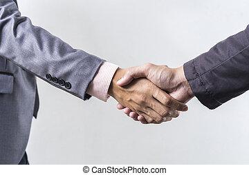 Business handshake on grey background
